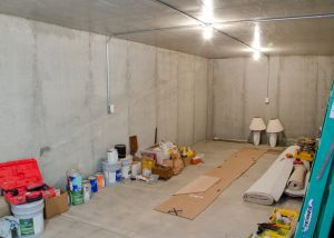 Concrete safe room under garage